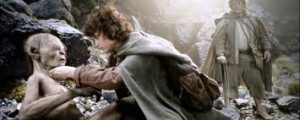 Frodo taking the rope off Gollum's neck.